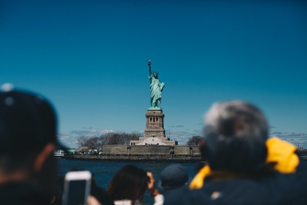 Tourists Looking at the Statue of Liberty
