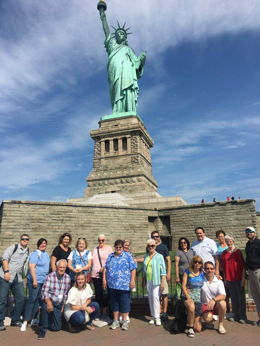 Tour Group in front of Statue of Liberty