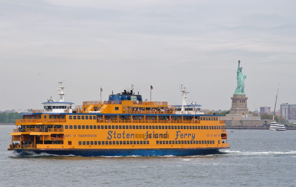 Staten Island Ferry in front of the Statue of Liberty