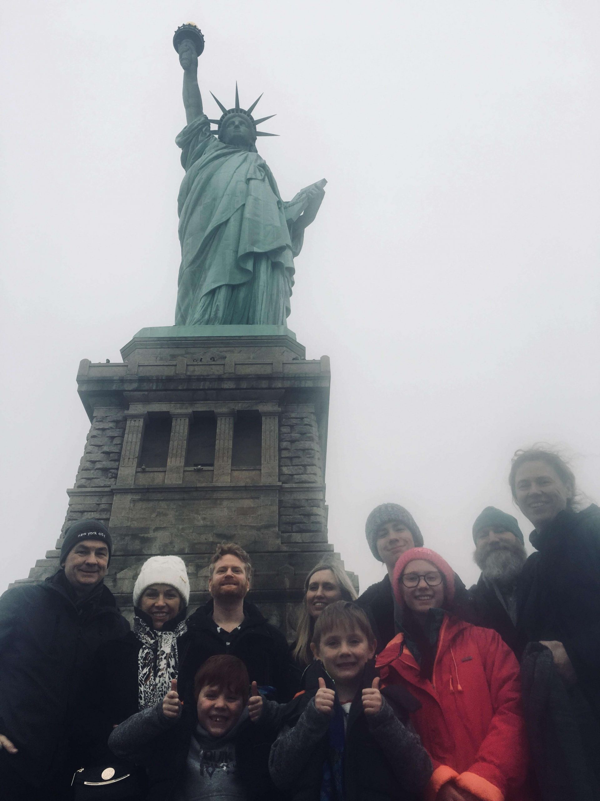 Group photo in front of the statue of liberty