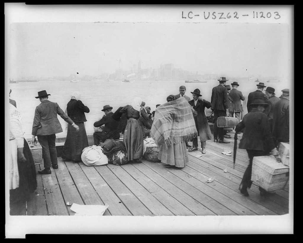 immigrants-waiting-to-be-transferred-ellis-island-