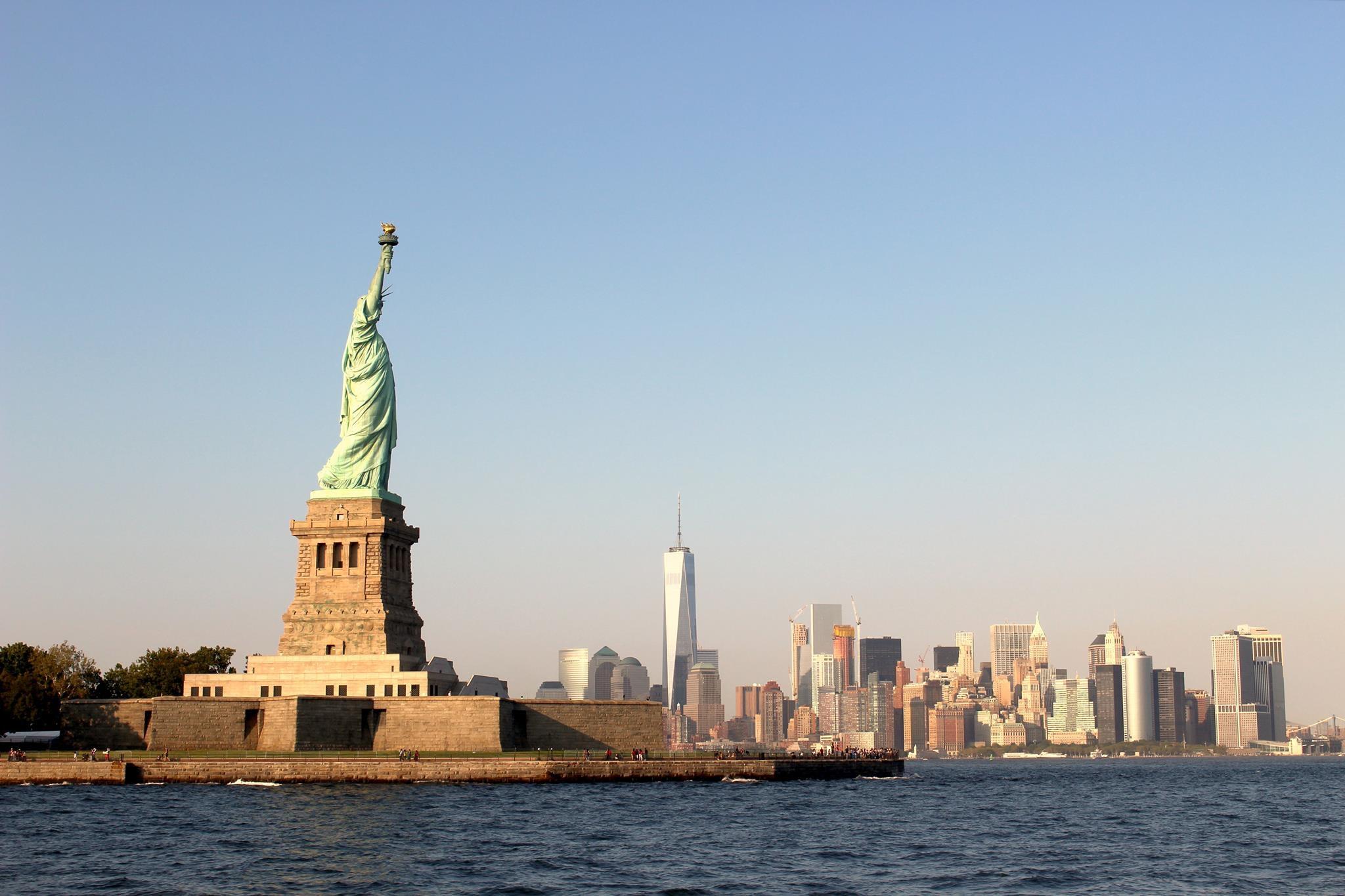 statue of liberty, new york skyline view
